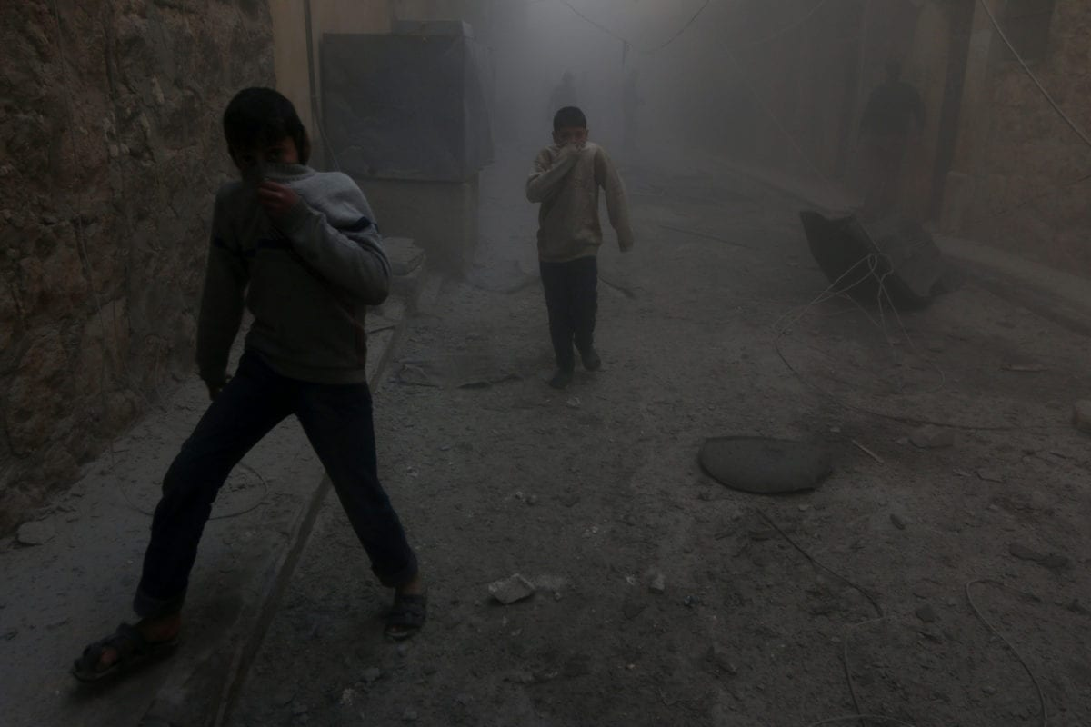 Smoke rises after the Syrian and Russian army carried out airstrikes over residential areas in Aleppo, Syria on 21 November 2016 [Jawad al Rifai/Anadolu Agency]