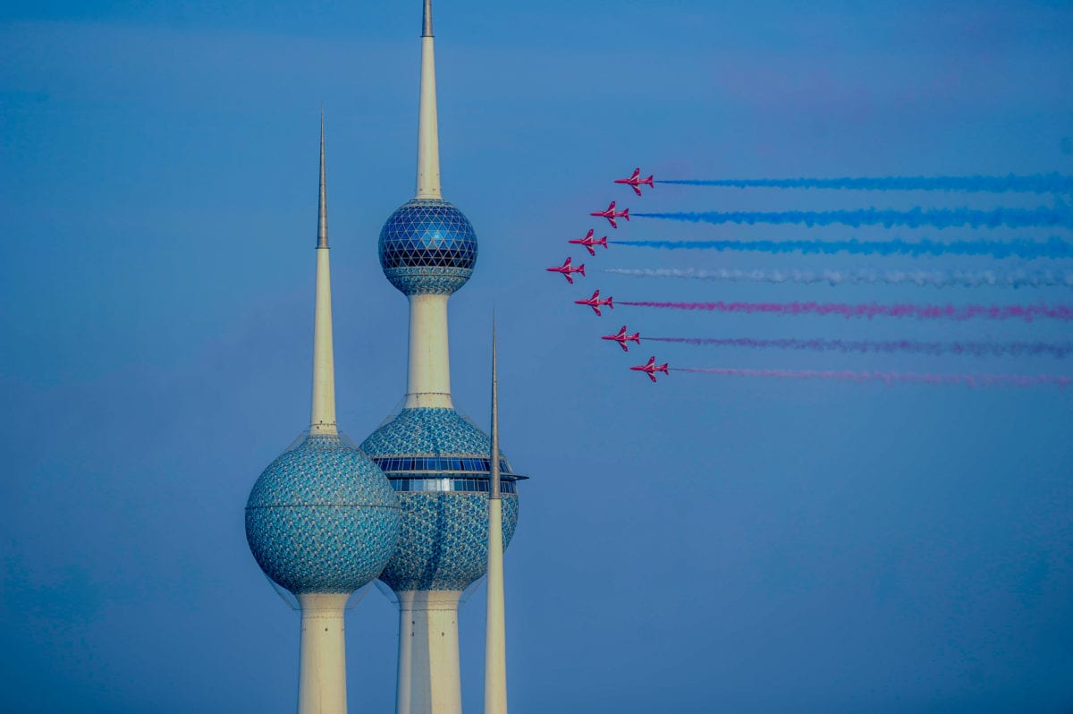 Red Arrows, officially known as the British Royal Air Force Aerobatic Team, perform a flypast in Kuwait on November 28 2016 [Jaber Abdulkhaleg/Anadolu Agency]
