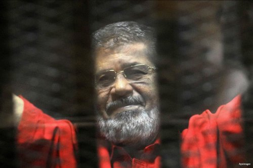 Egypt's ousted Islamist president Mohamed Morsi, wearing an orange uniform while in prison on 7th May 2016 [Apaimages]