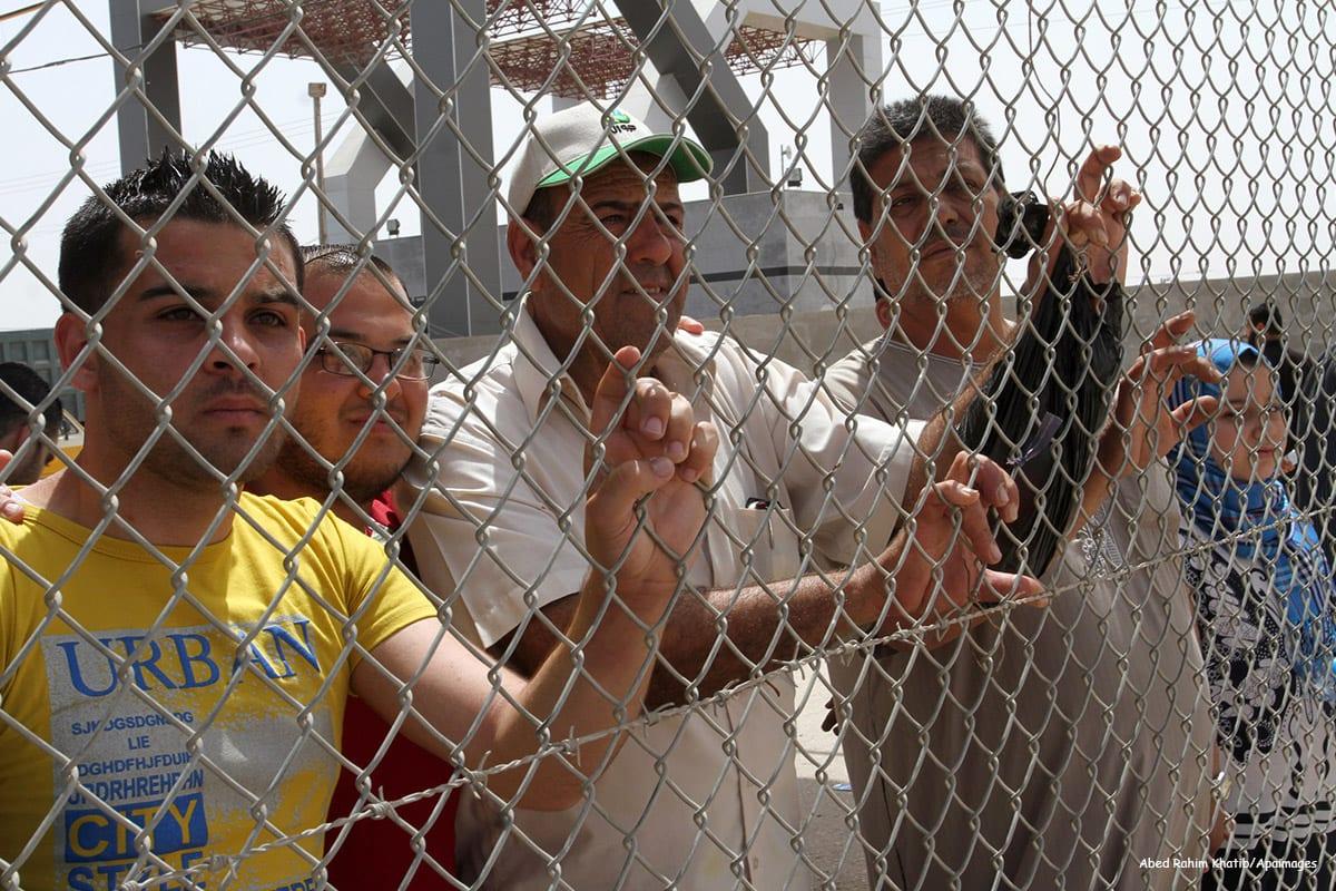 Palestinians wait behind fences for relatives coming through the Rafah border [Abed Rahim Khatib/Apaimages]