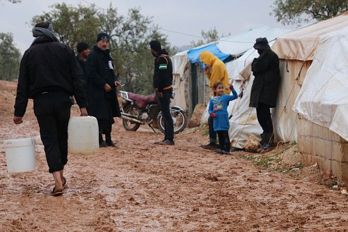 Image of Syrians, in the tent camp at the Atme village, are seen in difficult living conditions after torrential rains in Idlib, Syria on December 1, 2016 [Mahmoud Faisal/Anadolu Agency]