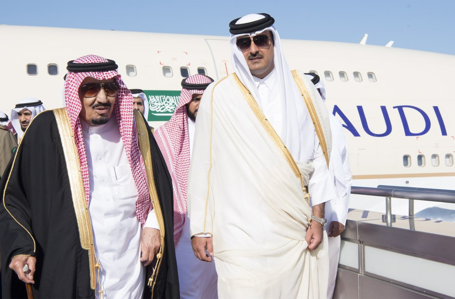 King of Saudi Arabia Salman Bin Abdulaziz (L) is welcomed by Emir of Qatar Sheikh Tamim bin Hamad Al Thani (R) at Hamad International Airport in Doha, Qatar on December 5, 2016. [Bandar Algaloud/Saudi Kingdom/Handout]
