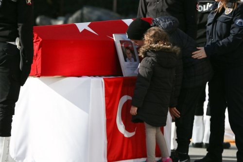 Relatives attend the funeral ceremony for the casualties of the Istanbul terror attacks at Istanbul Police Department headquarters in Istanbul, Turkey on December 11, 2016 [Arif Hüdaverdi Yaman / Anadolu Agency]