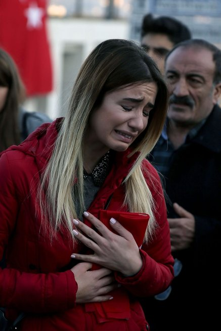 A woman cries as people leave carnations for the victims of Istanbul terror attacks near the Vodafone Arena in Istanbul's Besiktas, Turkey on December 11, 2016 [Onur Çoban / Anadolu Agency]