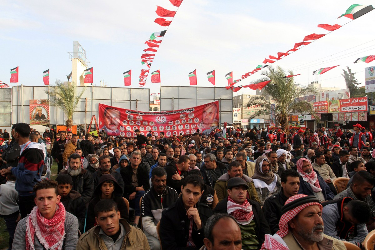 Palestinians gather to attend a rally marking the 49th anniversary of the founding of the Popular Front for the Liberation of Palestine (PFLP) in Rafah, Gaza on 13 December 2016 [Abed Rahim Khatib/Anadolu Agency]