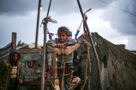 KHAN YUNIS, GAZA - DECEMBER 14: Palestinian children play outside as Palestinians living in makeshift homes in El-Zohor neighborhood in the city of Khan Yunis on the Gaza Strip are facing difficult conditions under the cold weather on December 14, 2016. The economy and their living conditions are getting progressively worse due to Israel's embargo on Gaza. ( Mustafa Hassona - Anadolu Agency )
