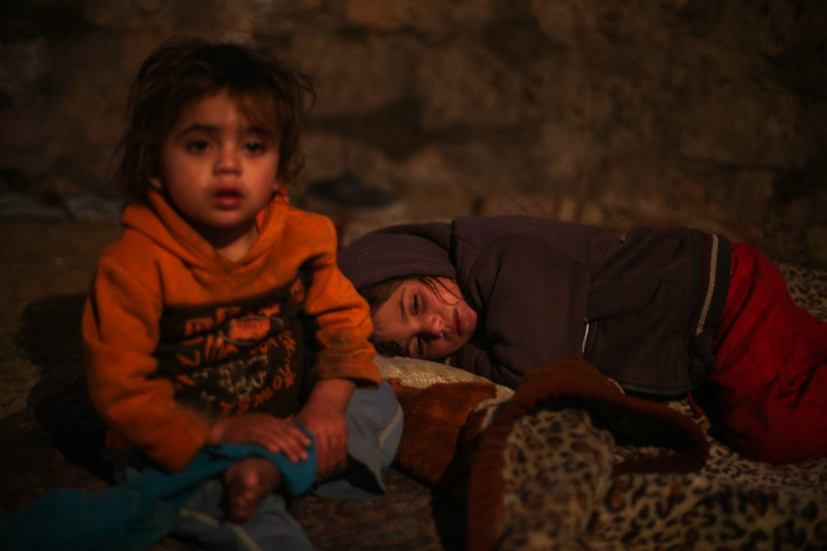 Palestinian children are seen at their house as Palestinians living in makeshift homes in El-Zohor neighborhood in the city of Khan Yunis on the Gaza Strip are facing difficult conditions under the cold weather on December 14, 2016. The economy and their living conditions are getting progressively worse due to Israel's embargo on Gaza [Mustafa Hassona / Anadolu Agency]
