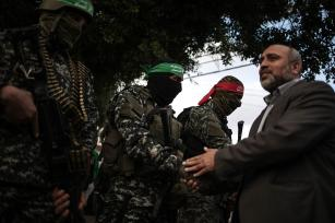 GAZA CITY, GAZA - DECEMBER 18: Izz ad-Din al-Qassam Brigades, military wing of Hamas movement, hold a commemoration ceremony for Hamas member Tunisian aircraft engineer Muhammed ez-Zevvari, who was assassinated in front of his house, in Gaza City, Gaza on December 18, 2016. ( Ali Jadallah - Anadolu Agency )