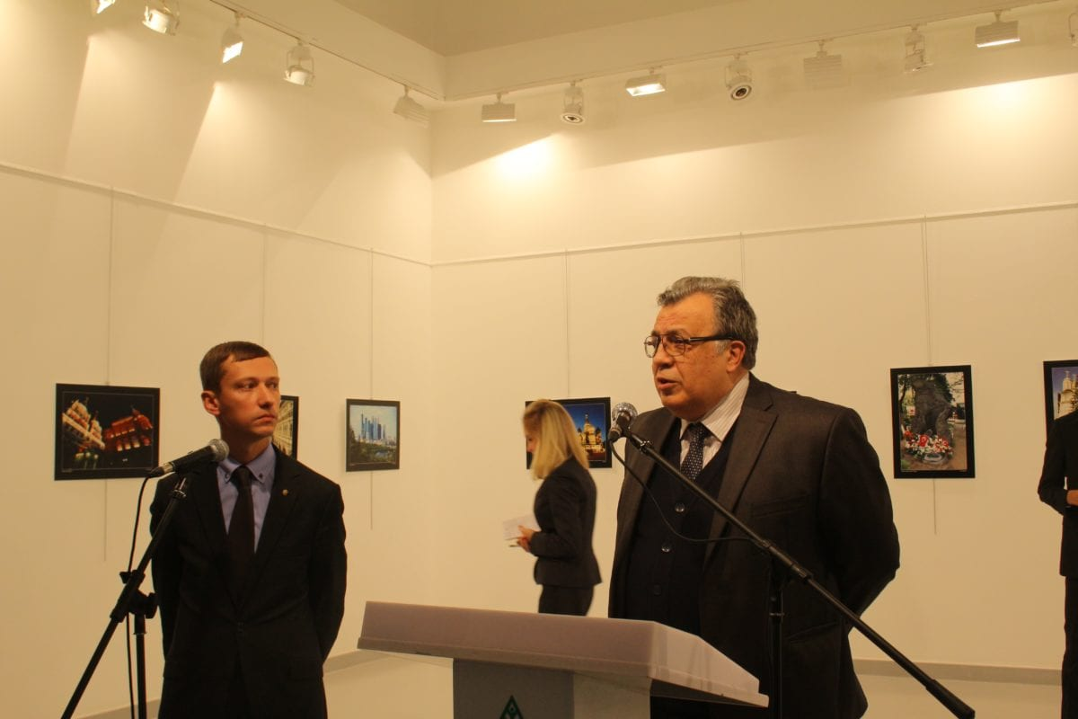 ANKARA, TURKEY: Russian Ambassador to Turkey, Andrei Karlov (R) gives a speech as he visits an art fair at Modern Art Center in Ankara, on 19 December 2016. Russian Ambassador to Turkey Andrei Karlov has been shot multiple times when an armed assailant opened fire on him. The envoy was seriously wounded and was taken to hospital immediately. [Ecenur Çolak/Anadolu Agency]
