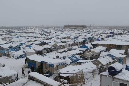 Snow sets on top of tents and make shift homes in Aleppo, Syria on December 21 2016 [Mamun Ebu Omer - Anadolu Agency]