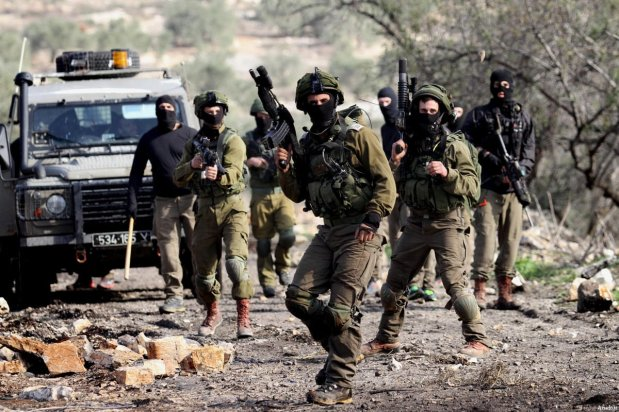 Israeli security forces clash with Palestinians during a protest against the nationalisation of the territories by Israeli government in Kafr Qaddum town of Nablus, West Bank on December 23, 2016 [Nedal Eshtayah / Anadolu Agency]
