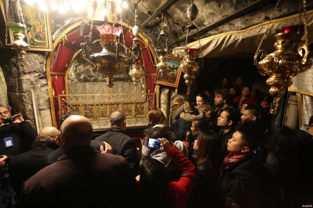 People visit the Church of the Nativity, which is traditionally considered to be located over the cave that marks the birthplace of Jesus, ahead of the Christmas in Bethlehem, West Bank on December 24, 2016 [Issam Rimawi / Anadolu Agency]