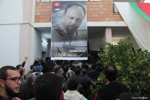 People gather to offer their condolences in front of 49-year-old Tunisian engineer and drone expert Mohamed Al-Zawari's house in Sfax, Tunisia on December 18, 2016 [Houssem Zawari / Anadolu Agency]