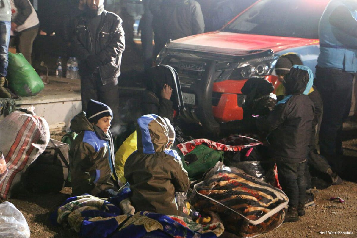 Image of Syrian children waiting to be evacuated in Aleppo, Syria [Aref Watad/Anadolu]