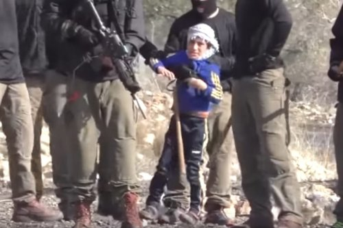 Israeli security forces take 7-year-old Muamen Murad Mahmoud Shteiwi into custody during a protest against the nationalisation of the territories by Israeli government in Kafr Qaddum town of Nablus, West Bank on December 23, 2016 [Nedal Eshtayah / Anadolu Agency]