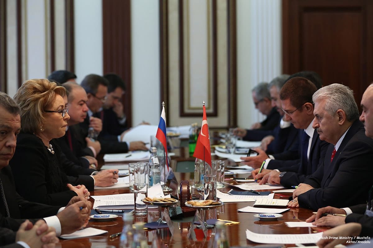 Image of a meeting in Moscow with Russian and Turkish delegations [Turkish Prime Ministry / Mustafa Aktas/Anadolu]
