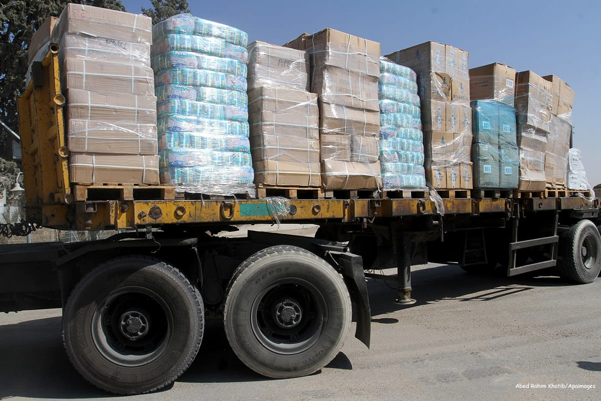 Image of a truck loaded with aid parcels in Gaza [Abed Rahim Khatib/Apaimages]