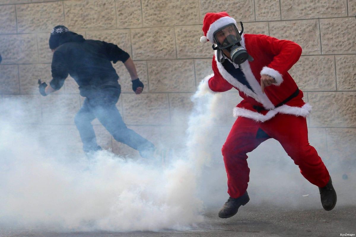 israeli forces suppress bethlehem u0027s u0027santa claus march u0027 with tear