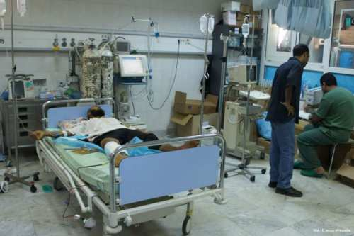 Image of a wounded man getting treatment from a hospital in Tripoli, Libya [VOA - E. Arrott/Wikipedia]