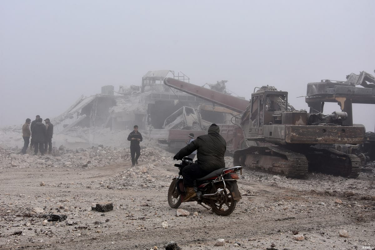A man inspects the area after warcrafts belonging to Assad Regime forces attacked with vacuum bomb to Etarib district of Aleppo, Syria on January 1, 2017 [Ahmed al Ahmed / Anadolu Agency]