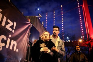 ISTANBUL, TURKEY - JANUARY 3: A woman and a man take part in a protest against Istanbul nightclub terror attack in Istanbul, Turkey on January 3, 2017. An armed terrorist attack killed at least 39 people and injured 69 -- four of them critically -- at an Istanbul nightclub during the new year celebrations on early hours of 1st of January, 2017. ( Berk Özkan - Anadolu Agency )