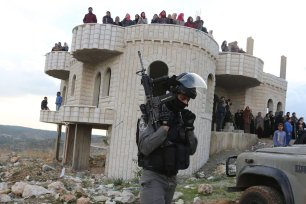 RAMALLAH, WEST BANK - JANUARY 4: Palestinians react to Israeli forces as they try to demolish a building that the building were unlicensed in Bedres town of Ramallah, West Bank on January 4, 2017 ( Issam Rimawi - Anadolu Agency )