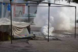 MEDENINE, TUNISIA - JANUARY 11: Police use tear gas to disperse the protesters demanding social rights to citizens and resolution of the crisis at Ras Jadir border crossing btween Libya and Tunisia, in Ben Gardane town of Medenine, Tunisia on January 11, 2017. ( Tasnim Nasri - Anadolu Agency )