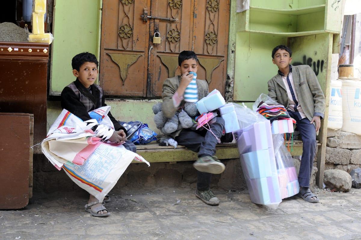 Yemeni children sell household objects to customers at Salt Bazaar in capital Sanaa, Yemen on January 22 2017 [Mohammed Hamoud - Anadolu Agency]