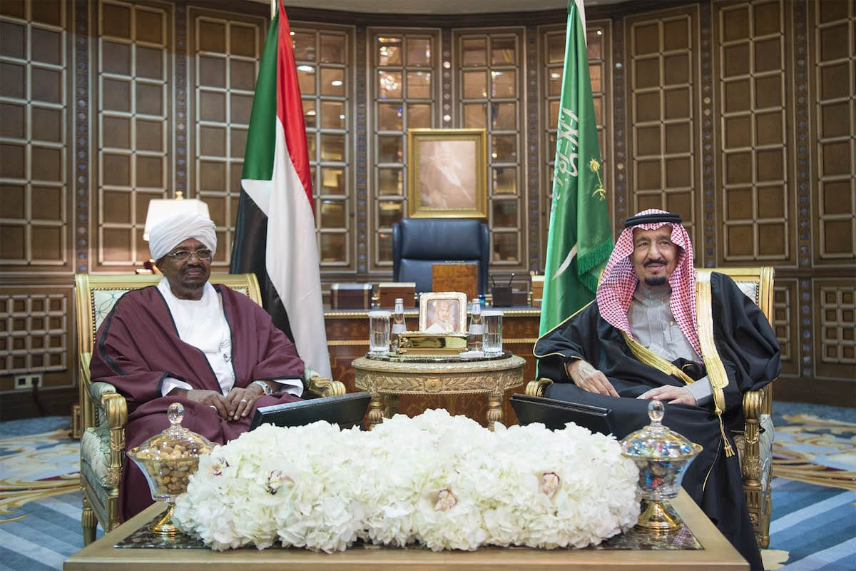 Image of President of Sudan Omar Al Bashir (L) and Saudi Arabia's King Salman bin Abdulaziz Al Saud (R) pose for a photo during their meeting at Palace of Yamamah in Riyadh, Saudi Arabia on 23 January 2017. [Bandar Algaloud / Saudi Royal Council / Handout - Anadolu Agency]