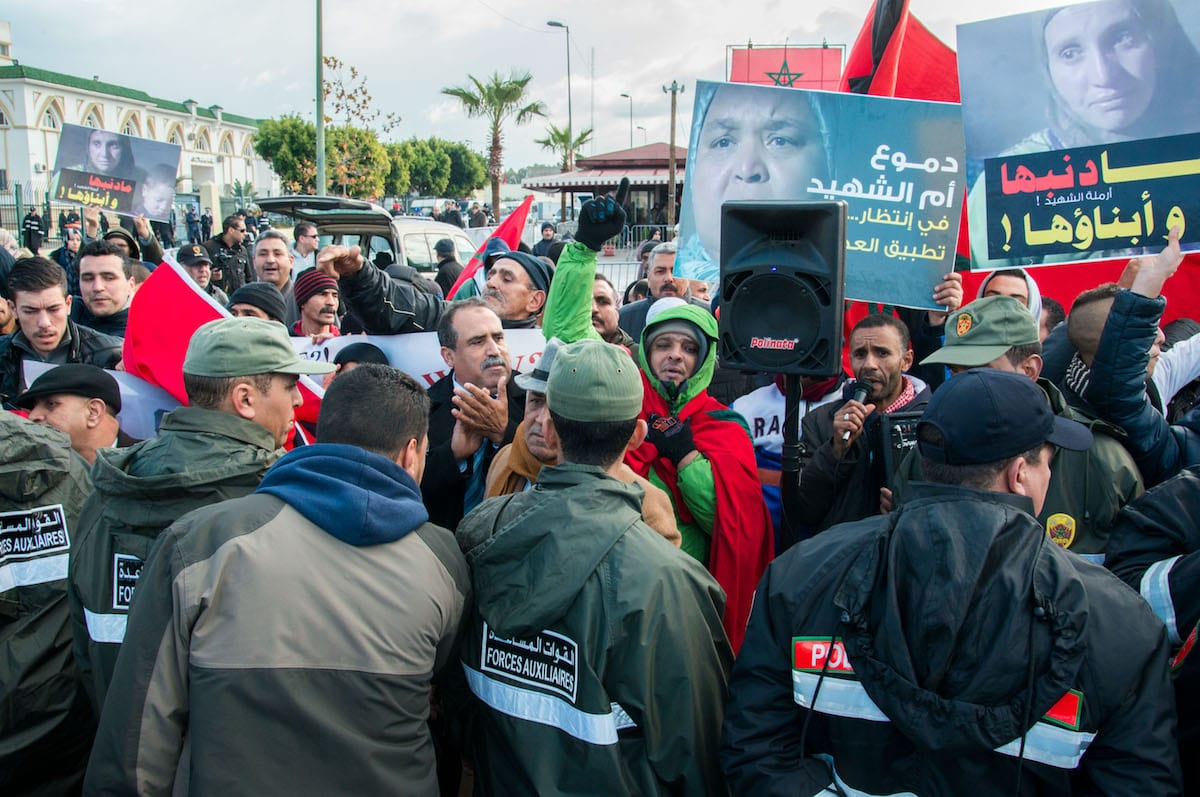 Moroccan people stage a protest demanding the release of their relatives during a demonstration against the killing of security forces in the Western Sahara in 2010, outside the building of the court of second trial of Sahrawis called Gdeim Izik group in Sale, Morocco on January 23 2017 [Jalal Morchidi - Anadolu Agency]