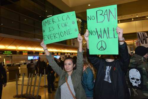 Demonstrators protest against a ban the Muslim ban at LA International Airport, California, on 28 January 2017 [Aydin Palabiyikoglu/Anadolu Agency]