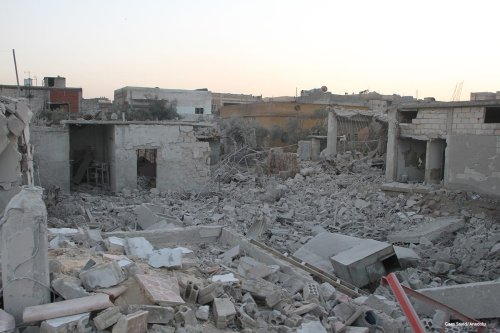Image of debris buildings are seen after being hit by airstrikes as the Assad regime continues to violate the ceasefire agreement in Syria on 12th January 2017 [Gaes Sayid/Anadolu]