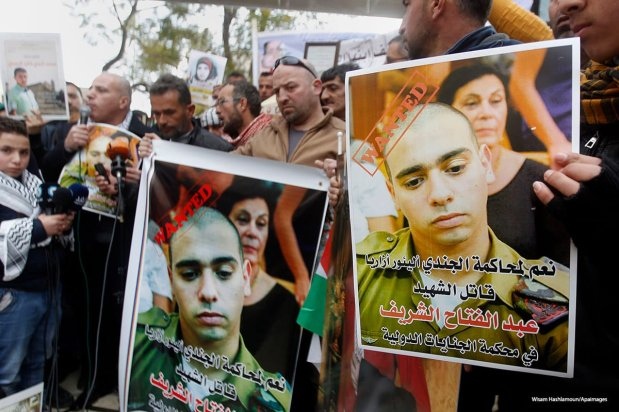Image of a demonstration against Elor Azarya, the Israeli soldier charged with manslaughter after shooting a wounded Palestinian in the head [Wisam Hashlamoun/Apaimages]