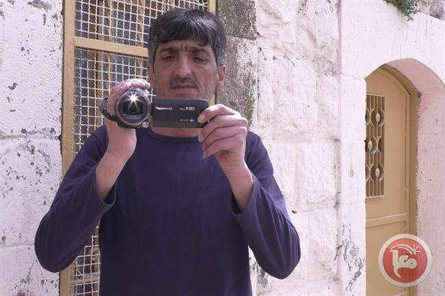 Activist Imad Abu Shamsiyya filmed an Israeli soldier shooting a maimed Palestinian who lay motionless on the ground in Hebron [Ma'an]