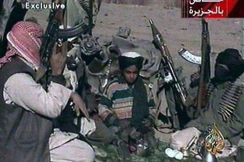 Picture from Al Jazeera TV purportedly showing Hamza bin Laden (centre), one of the sons of Osama bin Laden, seated between two Taliban fighters near Ghazni, Afghanistan in 2001 (Al-Jazeera TV)