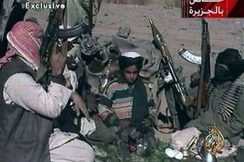 Picture from Al Jazeera TV purportedly showing Hamza bin Laden (centre), one of the sons of Osama bin Laden, seated between two Taliban fighters near Ghazni, Afghanistan in 2001 (Al-Jazeera TV)