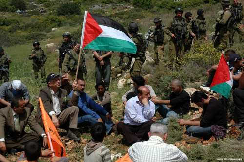 Palestinian protesters pray during a demonstration against Jewish settlements in the Palestinian village of Deir Estia in the occupied West Bank on 2 April 2010 [Najeh Hashlamoun/Apaimages]