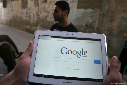 A Palestinian man holds his samsung tablet in Rafah in southern Gaza strip on 13th May 2013 [Eyad Al Baba/apaimages]