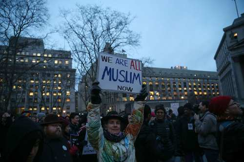 A woman holds a sign reading in 'We are all Muslims now' during a rally supporting immigration in New York City on February 1, 2017 [Mohammed Elshamy/Anadolu Agency]