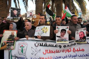NABLUS, WEST BANK - FEBRUARY 6: Protesters hold banners containing their relative pictures during a demonstration demanding the release of the Palestinians, held in Israeli prisons, in Nablus, West Bank on February 6, 2017. ( Nedal Eshtayah - Anadolu Agency )