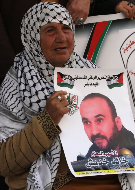 NABLUS, WEST BANK - FEBRUARY 6: A protester holds a banner containing her relative picture during a demonstration demanding the release of the Palestinians, held in Israeli prisons, in Nablus, West Bank on February 6, 2017. ( Nedal Eshtayah - Anadolu Agency )