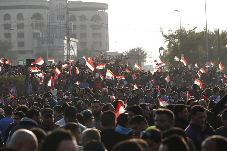 BAGHDAD, IRAQ - FEBRUARY 08: Supporters of Shia cleric Muqtada al-Sadr stage a protest, demanding change of the Iraq's Independent High Electoral Commission's members, at Green Zone, where governmental buildings located, in Baghdad, Iraq on February 08, 2017. ( Murtadha Sudani - Anadolu Agency )