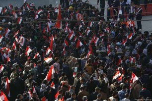 BAGHDAD, IRAQ - FEBRUARY 11: Thousands of supporters of Shia cleric Muqtada Al-Sadr stage a protest to demand the dissolution of Iraq's High Electoral Commission at Tahrir Square in Baghdad, Iraq on February 11, 2017. [Murtadha Sudani/Anadolu Agency]