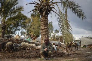 GAZA CITY, GAZA - FEBRUARY 12: A Bedouin man is seen near their makeshift huts -without water and basic living necessities, at Gaza Valley in Gaza City, Gaza on February 12, 2017. After become homeless, many Bedouins try to continue their lives under hard conditions. ( Mustafa Hassona - Anadolu Agency )