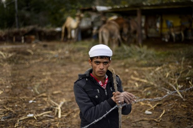 GAZA CITY, GAZA - FEBRUARY 12: A Bedouin man is seen near their makeshift huts -without water and basic living necessities, at Gaza Valley in Gaza City, Gaza on February 12, 2017. After becoming homeless, many Bedouins try to continue their lives under hard conditions. ( Mustafa Hassona - Anadolu Agency )