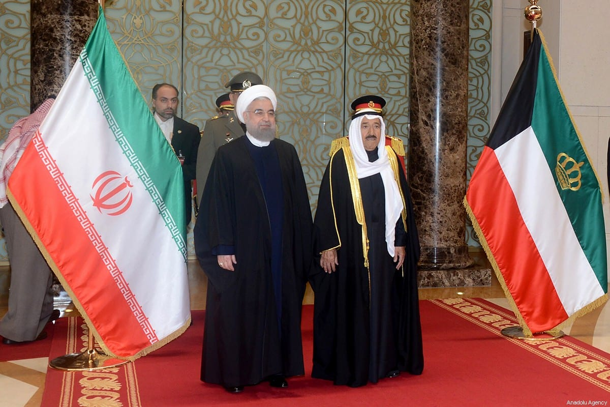 Iranian President Hassan Rouhani (L) is welcomed by Emir of Kuwait Sabah Al Ahmad Al Jaber Al Sabah (R) at Kuwait International Airport in Kuwait City on 15 February 15 2017. [Kuwaiti Council/Anadolu Agency]