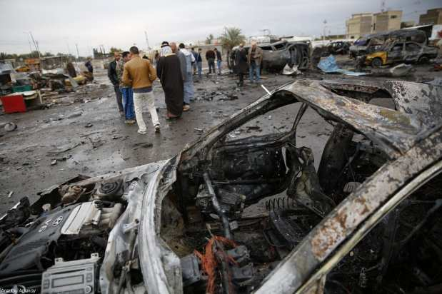 BAGHDAD, IRAQ - FEBRUARY 17: A wreckage of a car is seen a day after a car bomb attack at al-Bayaa auto gallery in capital of Baghdad, Iraq on February 17, 2017. Many casualities reported after the attack. ( Murthadha Sudani - Anadolu Agency )