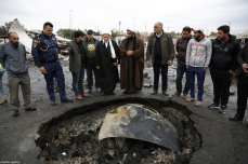 BAGHDAD, IRAQ - FEBRUARY 17: Men inspect the wreckage of a car a day after a car bomb attack at al-Bayaa auto gallery in capital of Baghdad, Iraq on February 17, 2017. Many casualities reported after the attack. ( Murthadha Sudani - Anadolu Agency )