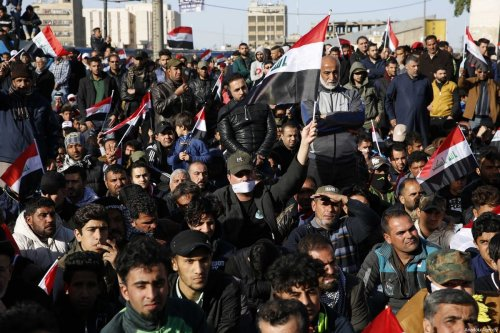 "Thousands of supporters of Shia cleric Muqtada Al-Sadr stage a ""silent"" protest to demand the dissolution of Iraq's High Electoral Commission at Tahrir Square in Baghdad, Iraq on 17 February 2017. [Murtadha Sudani/Anadolu Agency]"