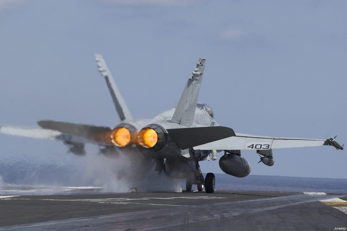 A US F18 Hornet aircraft is launched off the deck of US aircraft carrier USS George Washington during its mission in the eastern Mediterranean Sea on February 21, 2017 [Murat Kaynak / Anadolu Agency]